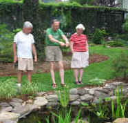 Picture of neighbors discussing lovely landscaped pond