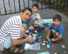 Kin and his boys working on Legos