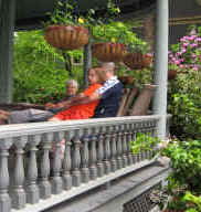 Generations lounge on the wide Victorian porch and visit